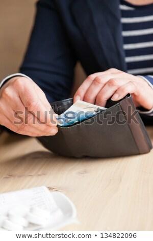 Strony garnitur na zewnątrz euro portfela świetle Zdjęcia stock © ra2studio
