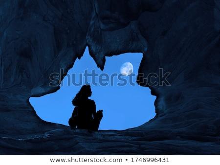 Fiatal nő ül hegyek szirt néz kék Stock fotó © vapi