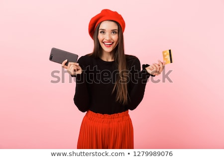 Portrait of an excited young woman wearing beret Stock photo © deandrobot