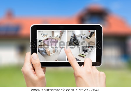 Person Monitoring Smart House On Digital Tablet Stock photo © AndreyPopov