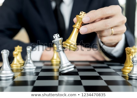 businessman playing  chess figure take a checkmate another king  Stock photo © snowing