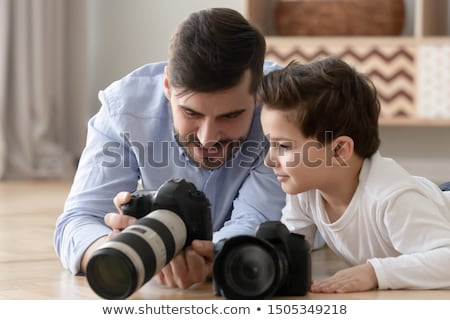 Smiling school boy photographer with DSLR camera Stock photo © darrinhenry