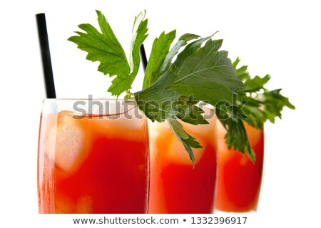 cropped view of bloody mary with ice cubes with celery on white stock photo © dla4