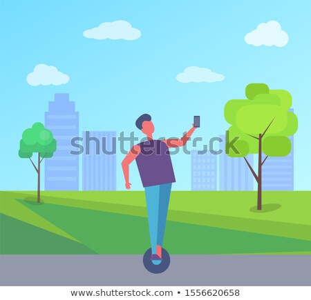 Man Riding on Segway and Taking Selfie City Park Stock photo © robuart