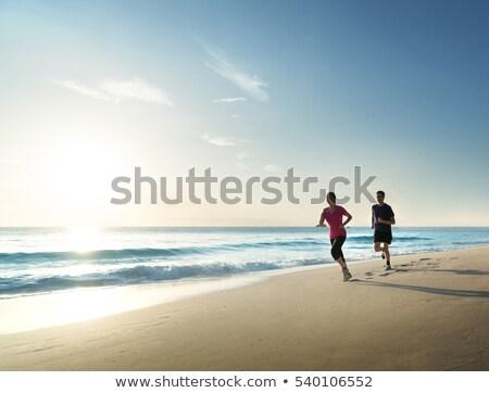 Jonge atletisch paar jogging tropisch strand hot Stockfoto © majdansky