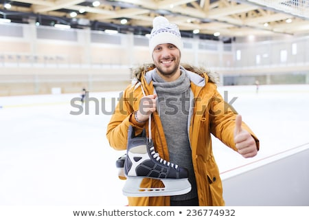 happy young man showing thumbs up on skating rink Stock photo © dolgachov