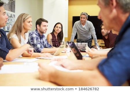 people are working together on large screen stock photo © sgursozlu