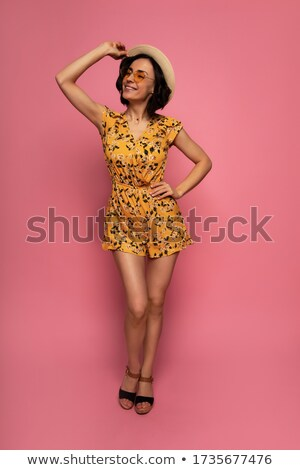 Full-length image of woman in dress, straw hat and sunglasses Stock photo © deandrobot