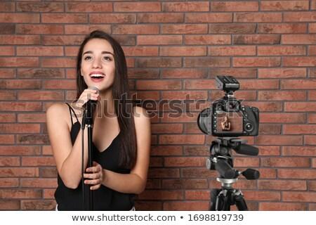 Singing for camera Stock photo © pressmaster