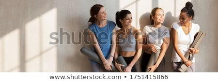 Group of sportive happy women holding yoga mats standing indoors Stock photo © dashapetrenko