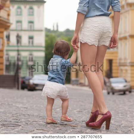 young mother on street with tiny daughter girl stock photo © lopolo