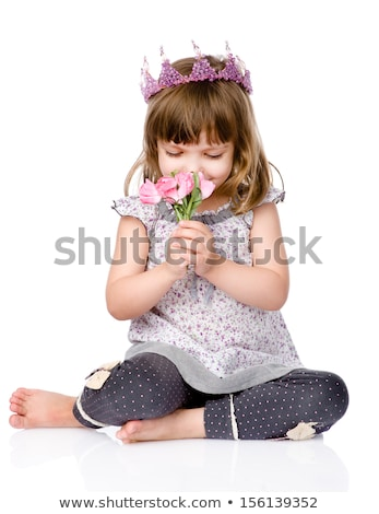 Adorable little girl with small crown on head sitting in isolation Stock photo © pressmaster