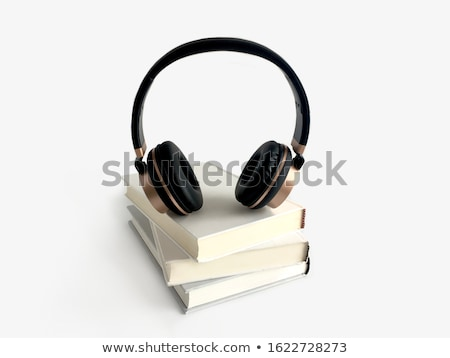 Audio livre noir casque livres tasse Photo stock © neirfy