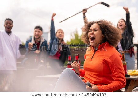 Emotional friends cheering for their favorite hockey team Stock photo © pressmaster