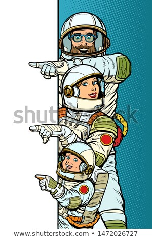 Family astronauts mom dad and son. Point to copy space poster Stock photo © studiostoks