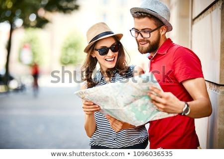 Szczęśliwy kobiet miasta przewodnik Pokaż lata Zdjęcia stock © dolgachov