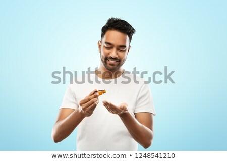 Indian man olie hand aromatherapie Stockfoto © dolgachov