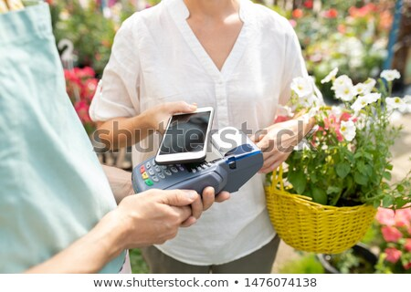 Using contactless payment in flower store Stock photo © pressmaster