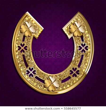golden horseshoe with leaf clover stock photo © mayboro