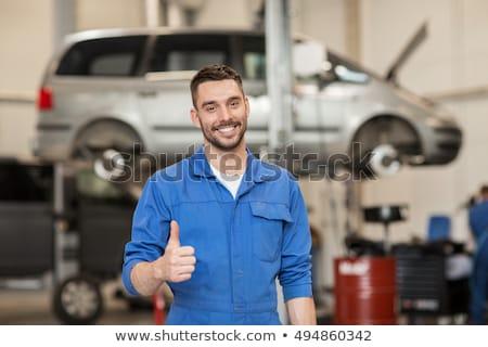 Сток-фото: Smiling Male Technician Showing Thumbs Up Sign
