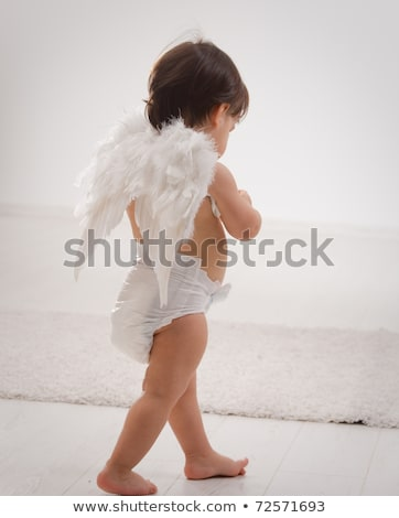 baby girl wearing angel wings isolated on white stock photo © lopolo