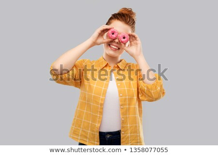 funny teenage girl with donuts instead of eyes stock photo © dolgachov