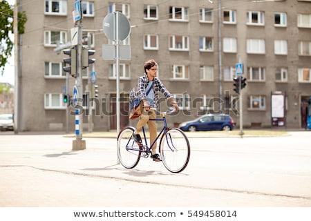 Jóvenes hombre bolsa equitación fijado Foto stock © dolgachov