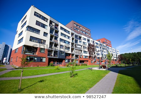 Newly built white apartment buildings Stock photo © elxeneize