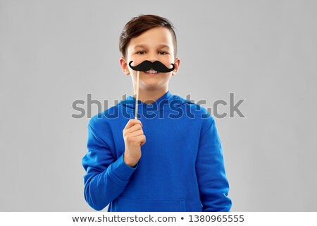smiling boy in blue hoodie with black moustaches Stock photo © dolgachov