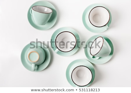 empty coffee cups with saucers on table setting Stock photo © inxti
