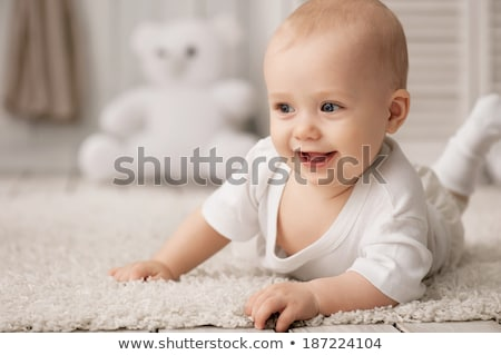 hands of baby crawling on floor or carpet Stock photo © dolgachov