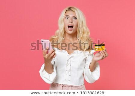 Afbeelding verwonderd blonde vrouw mobieltje creditcard Stockfoto © deandrobot