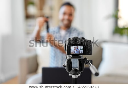 male blogger recording video review of smart watch Stock photo © dolgachov