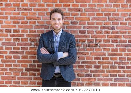 Smart casuale imprenditore urbana città muro di mattoni Foto d'archivio © Maridav