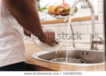 Guy Morgen Küche waschen Gerichte Stock foto © deandrobot