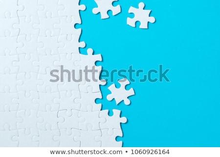 Befejezetlen puzzle kép kék háttér csoport Stock fotó © magann