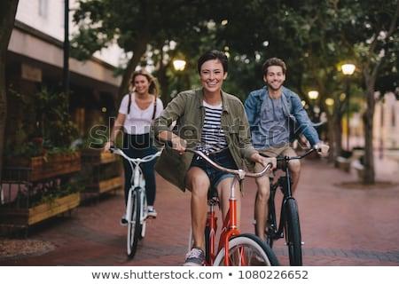 drie · fietsen · beneden · familie · paardrijden - stockfoto © pressmaster