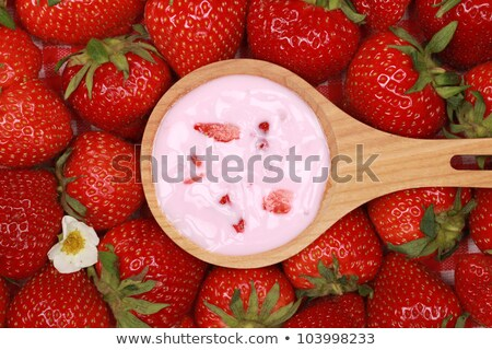 yogurt on a spoon over a dessert Stock photo © Rob_Stark