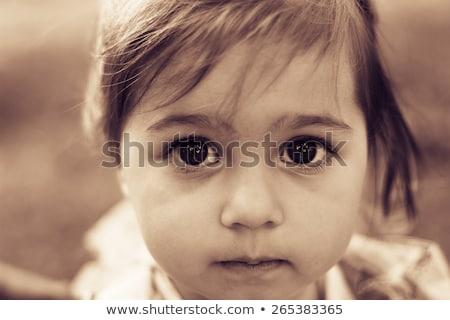 portret · armoede · weinig · jongen · triest · ogen - stockfoto © zurijeta