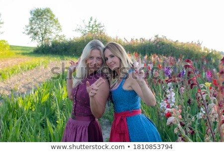 two bavarian girls with pretzels cheering with beer stock photo © Rob_Stark