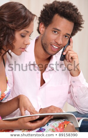 Couple ordering goods over the telephone Stock photo © photography33