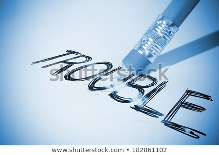 eraser and word trouble Stock photo © devon
