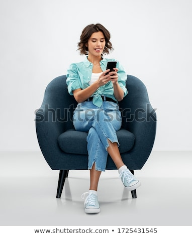 Szépség barna hajú ül fotel fa divat Stock fotó © konradbak