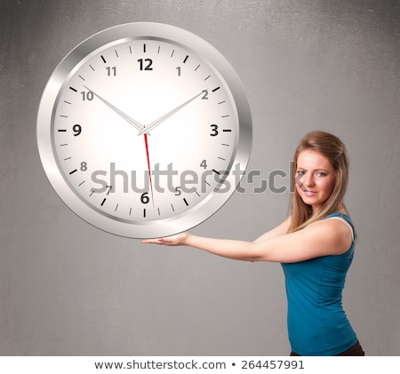 woman holding a huge clock Stock photo © photography33