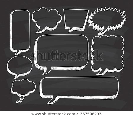 Chalk drawing of blank speech bubbles on a blackboard background Stock photo © bbbar