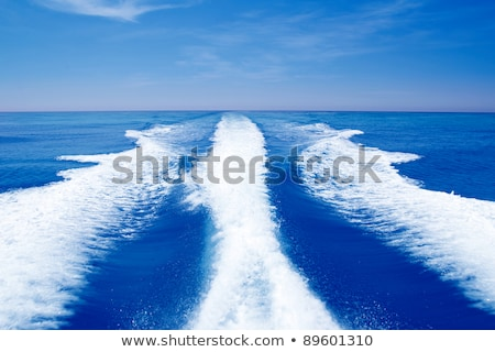 Boat wake prop wash foam in blue sky Stock photo © lunamarina