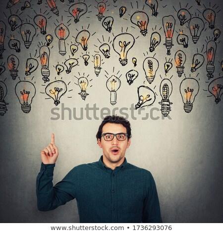 Astonished businessman pointing upward  Stock photo © wavebreak_media