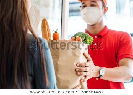 red woman with mask stock photo © carlodapino