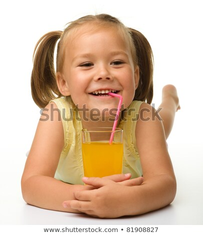 Little girl drinking juice using a straw Stock photo © photography33