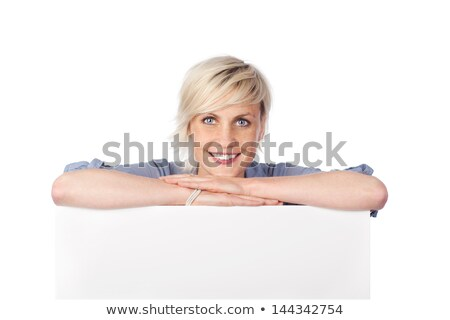 Friendly business people holding a poster against white background Stock photo © wavebreak_media